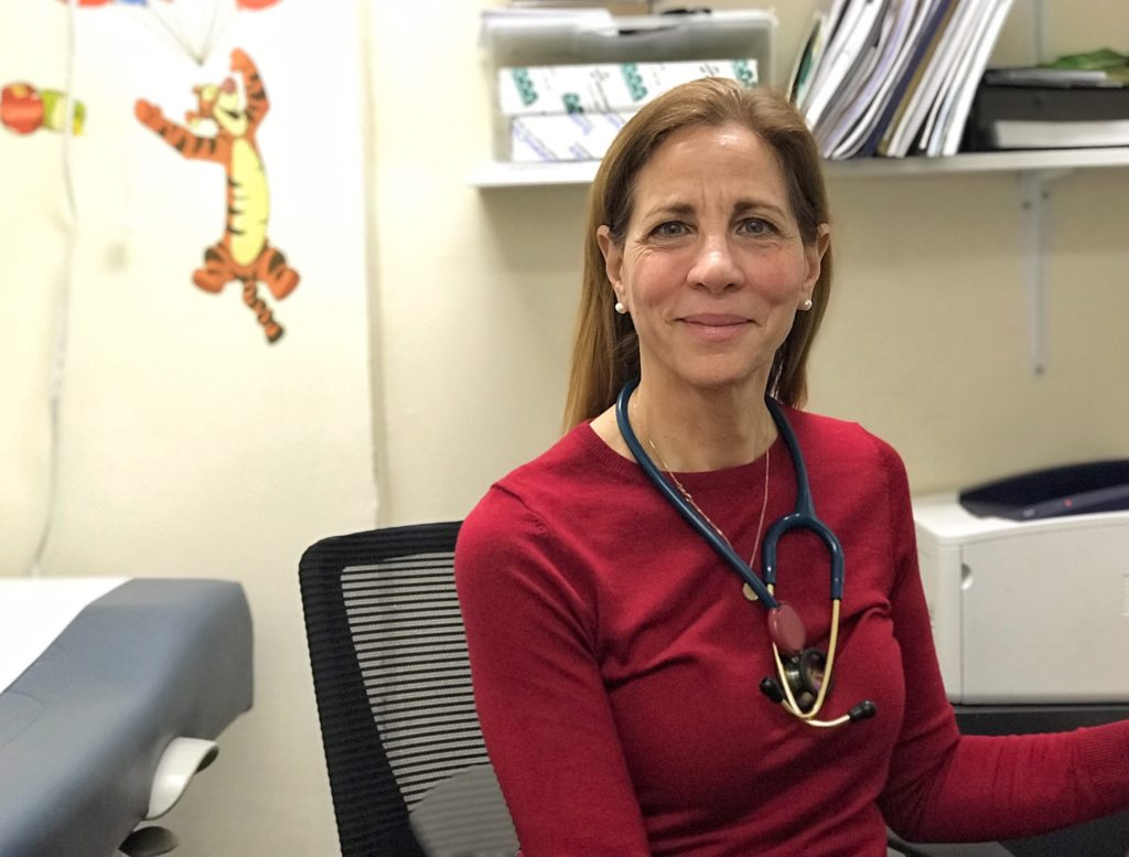 Care For the Homeless nurse practitioner, Joy Favuzza sitting in her office at the Jackson Family Residence Health Center in the Bronx.